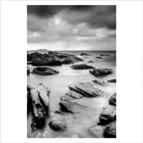 Fotomural dormitorio mar y rocas
